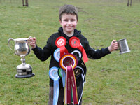 Jack with the rosettes and trophies at the Newfoundland Club Open Show 2010